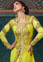 Dreamy variation on shape and forms compliment your style with tradition. The dazzling lime green net long style anarkali churidar suit have amazing embroidery patch work is done with resham, zari, stone and lace work. Beautiful embroidery work on kameez is stunning. The entire ensemble makes an excellent wear. Matching santoon churidar and chiffon dupatta is available with this suit. Slight Color variations are possible due to differing screen and photograph resolutions.