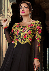 Look stunning rich with dark shades and floral patterns. The dazzling black georgette long style anarkali churidar suit have amazing embroidery patch work is done with resham, zari, stone and lace work. Beautiful embroidery work on kameez is stunning. The entire ensemble makes an excellent wear. Matching santoon churidar and chiffon dupatta is available with this suit. Slight Color variations are possible due to differing screen and photograph resolutions.