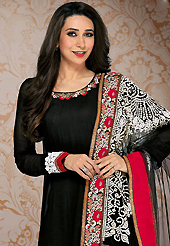 It is color this season and bright shaded suits are really something that is totally in vogue. The dazzling black georgette churidar suit have amazing embroidery patch work is done with resham work. Beautiful embroidery work on kameez is stunning. The entire ensemble makes an excellent wear. Contrasting red santoon churidar and black and cream net dupatta is available with this suit. Slight Color variations are possible due to differing screen and photograph resolutions.