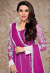 Your search for elegant look ends here with this lovely suit. The dazzling magenta net churidar suit have amazing embroidery patch work is done with resham, sequins and lace work. Beautiful embroidery work on kameez is stunning. The entire ensemble makes an excellent wear. Contrasting white santoon churidar and magenta net dupatta is available with this suit. Slight Color variations are possible due to differing screen and photograph resolutions.