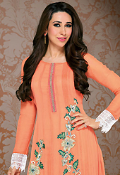 The color range from natural shades looks ravishing. The dazzling light orange georgette churidar suit have amazing embroidery patch work is done with resham and lace work. Beautiful embroidery work on kameez is stunning. The entire ensemble makes an excellent wear. Contrasting green santoon churidar and light orange dupatta is available with this suit. Slight Color variations are possible due to differing screen and photograph resolutions.