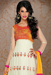 A desire that evokes a sense of belonging with a striking details. The dazzling cream net anarkali churidar suit have amazing embroidery patch work is done with resham, zari and sequins work. Beautiful embroidery work on kameez is stunning. The entire ensemble makes an excellent wear. Contrasting pink santoon churidar and yellow and pink chiffon dupatta is available with this suit. Slight Color variations are possible due to differing screen and photograph resolutions.
