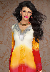 Dreamy variation on shape and forms compliment your style with tradition. The dazzling shaded cream, orange and red georgette churidar suit have amazing embroidery patch work is done with resham, sequins, stone and lace work. Beautiful embroidery work on kameez is stunning. The entire ensemble makes an excellent wear. Matching red santoon churidar and red chiffon dupatta is available with this suit. Slight Color variations are possible due to differing screen and photograph resolutions.