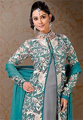 This season dazzle and shine in pure colors. The dazzling grey and turquoise net and georgette jacket style churidar suit or lehenga have amazing embroidery patch work is done with resham work. Beautiful embroidery work on kameez is stunning. The entire ensemble makes an excellent wear. Matching turquoise santoon churidar or lehenga and turquoise chiffon dupatta is available with this suit. Slight Color variations are possible due to differing screen and photograph resolutions.