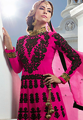Look stunning rich with dark shades and floral patterns. The dazzling dark pink georgette anarkali churidar suit have amazing embroidery and velvet patch work is done with resham, zari and stone work. Beautiful embroidery work on kameez is stunning. The entire ensemble makes an excellent wear. Matching santoon churidar and chiffon dupatta is available with this suit. Slight Color variations are possible due to differing screen and photograph resolutions.