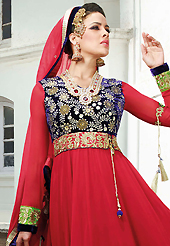 The glamorous silhouette to meet your most dire fashion needs. The dazzling red georgette anarkali churidar suit have amazing embroidery and velvet patch work is done with zari and stone work. Beautiful embroidery work on kameez is stunning. The entire ensemble makes an excellent wear. Matching santoon churidar and chiffon dupatta is available with this suit. Slight Color variations are possible due to differing screen and photograph resolutions.