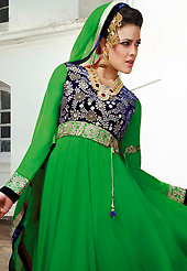 Breathtaking collection of suits with stylish embroidery work and fabulous style. The dazzling green georgette anarkali churidar suit have amazing embroidery and velvet patch work is done with zari and stone work. Beautiful embroidery work on kameez is stunning. The entire ensemble makes an excellent wear. Matching santoon churidar and chiffon dupatta is available with this suit. Slight Color variations are possible due to differing screen and photograph resolutions.
