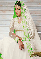Your search for elegant look ends here with this lovely suit. The dazzling white georgette anarkali churidar suit have amazing embroidery patch work is done with zari, sequins, stone and lace work. Beautiful embroidery work on kameez is stunning. The entire ensemble makes an excellent wear. Matching santoon churidar and net dupatta is available with this suit. Slight Color variations are possible due to differing screen and photograph resolutions.