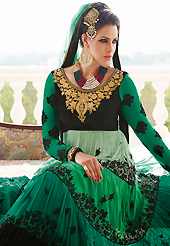 The glamorous silhouette to meet your most dire fashion needs. The dazzling shaded green and black georgette and velvet anarkali churidar suit have amazing embroidery patch work is done with resham, zari, stone and beads work. Beautiful embroidery work on kameez is stunning. The entire ensemble makes an excellent wear. Matching green santoon churidar and green chiffon dupatta is available with this suit. Slight Color variations are possible due to differing screen and photograph resolutions.
