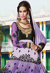 Dreamy variation on shape and forms compliment your style with tradition. The dazzling shaded purple and black georgette and velvet anarkali churidar suit have amazing embroidery patch work is done with resham, zari, stone and beads work. Beautiful embroidery work on kameez is stunning. The entire ensemble makes an excellent wear. Matching green santoon churidar and green chiffon dupatta is available with this suit. Slight Color variations are possible due to differing screen and photograph resolutions.