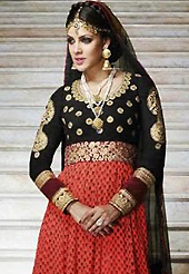 It is color this season and bright shaded suits are really something that is totally in vogue. The dazzling red and black georgette anarkali churidar suit have amazing embroidery patch work is done with floral print, zari and stone work. Beautiful embroidery work on kameez is stunning. The entire ensemble makes an excellent wear. Matching black santoon churidar and black net dupatta is available with this suit. Slight Color variations are possible due to differing screen and photograph resolutions.