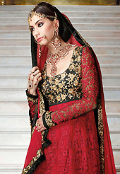 Outfit is a novel ways of getting yourself noticed. The dazzling maroon and black net anarkali churidar suit have amazing embroidery patch work is done with resham, zari, stone and beads work. Beautiful embroidery work on kameez is stunning. The entire ensemble makes an excellent wear. Matching maroon santoon churidar and maroon chiffon dupatta is available with this suit. Slight Color variations are possible due to differing screen and photograph resolutions.