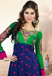 Attract all attentions with this embroidered suit. The dazzling dark blue and green faux georgette anarkali churidar suit have amazing embroidery patch work is done with resham, zari and stone work. The entire ensemble makes an excellent wear. Contrasting dark pink santoon churidar and dark pink chiffon dupatta is available with this suit. Slight Color variations are possible due to differing screen and photograph resolutions.