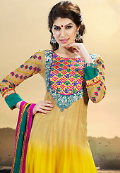 Take a look on the changing fashion of the season. The dazzling shaded yellow net anarkali churidar suit have amazing embroidery patch work is done with resham, zari and sequins work. The entire ensemble makes an excellent wear. Matching yellow santoon churidar and teal green chiffon dupatta is available with this suit. Slight Color variations are possible due to differing screen and photograph resolutions.