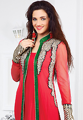 The color range from natural shades looks ravishing. The dazzling red faux georgette and net churidar suit have amazing embroidery patch work is done with resham, zari and sequins work. The entire ensemble makes an excellent wear. Matching santoon churidar and chiffon dupatta is available with this suit. Slight Color variations are possible due to differing screen and photograph resolutions.