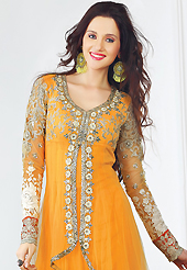 Attract all attentions with this embroidered suit. The dazzling bright yellow net churidar suit have amazing embroidery patch work is done with resham, zari, sequins, stone, beads and lace work. The entire ensemble makes an excellent wear. Matching santoon churidar and chiffon dupatta is available with this suit. Slight Color variations are possible due to differing screen and photograph resolutions.