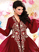 Your search for elegant look ends here with this lovely suit. The dazzling maroon georgette churidar suit have amazing embroidery patch work is done with resham, sequins and stone work. Beautiful embroidery work on kameez is stunning. The entire ensemble makes an excellent wear. Matching santoon churidar and chiffon dupatta is available with this suit. Slight Color variations are possible due to differing screen and photograph resolutions.