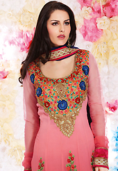 It is color this season and bright shaded suits are really something that is totally in vogue. The dazzling shaded pink georgette churidar suit have amazing embroidery patch work is done with resham, sequins, stone and lace work. Beautiful embroidery work on kameez is stunning. The entire ensemble makes an excellent wear. Matching santoon churidar and dark blue chiffon dupatta is available with this suit. Slight Color variations are possible due to differing screen and photograph resolutions.