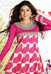 Outfit is a novel ways of getting yourself noticed. The dazzling pink and white net churidar suit have amazing embroidery patch work is done with resham, zari, sequins, stone and lace work. Beautiful embroidery work on kameez is stunning. The entire ensemble makes an excellent wear. Matching churidar and dupatta is available with this suit. Slight Color variations are possible due to differing screen and photograph resolutions.