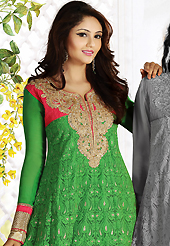 Take a look on the changing fashion of the season. The dazzling green net churidar suit have amazing embroidery patch work is done with resham, zari, sequins, stone, cutdana and lace work. Beautiful embroidery work on kameez is stunning. The entire ensemble makes an excellent wear. Matching churidar and dupatta is available with this suit. Slight Color variations are possible due to differing screen and photograph resolutions.