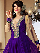 Your search for elegant look ends here with this lovely suit. The dazzling purple net readymade churidar suit have amazing embroidery patch work is done with stone, gold zardosi, cutdana, beads and lace work. The entire ensemble makes an excellent wear. Contrasting beige santoon churidar and beige net dupatta is available with this suit. Slight Color variations are possible due to differing screen and photograph resolutions.