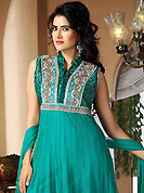 The color range from natural shades looks ravishing. The dazzling turquoise green net readymade churidar suit have amazing embroidery patch work is done with zari, stone and cutdana work. The entire ensemble makes an excellent wear. Matching churidar and dupatta is available with this suit. Slight Color variations are possible due to differing screen and photograph resolutions.