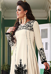 Take a look on the changing fashion of the season. The dazzling off white lawn cotton churidar suit have amazing embroidery patch work is done with resham and beads work. The entire ensemble makes an excellent wear. Matching cambric cotton churidar and black and off white chiffon dupatta is available with this suit. Slight Color variations are possible due to differing screen and photograph resolutions.