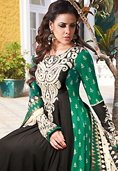 Outfit is a novel ways of getting yourself noticed. The dazzling black and green lawn cotton churidar suit have amazing embroidery patch work is done with resham and stone work. The entire ensemble makes an excellent wear. Matching cambric cotton churidar and off white chiffon dupatta is available with this suit. Slight Color variations are possible due to differing screen and photograph resolutions.