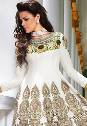 Your search for elegant look ends here with this lovely suit. The dazzling white lawn cotton anarkali churidar suit have amazing embroidery patch work is done with resham and beads work. The entire ensemble makes an excellent wear. Contrasting yellow cambric cotton churidar and off white chiffon dupatta is available with this suit. Slight Color variations are possible due to differing screen and photograph resolutions.