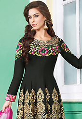 The glamorous silhouette to meet your most dire fashion needs. The dazzling black lawn cotton anarkali churidar suit have amazing embroidery patch work is done with resham and beads work. The entire ensemble makes an excellent wear. Contrasting pink cambric cotton churidar and shaded chiffon dupatta is available with this suit. Slight Color variations are possible due to differing screen and photograph resolutions.