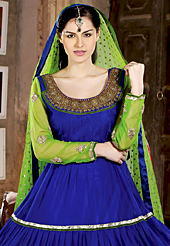 The fascinating beautiful subtly garment with lovely patterns. The dazzling royal blue net anarkali churidar suit have amazing embroidery patch work is done with zari, stones, beads and lace work. Beautiful embroidery work on kameez is stunning. The entire ensemble makes an excellent wear. Matching santoon churidar and green dupatta is available with this suit. Slight Color variations are possible due to differing screen and photograph resolutions.