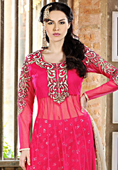 Take a look on the changing fashion of the season. The dazzling dark pink net churidar suit have amazing embroidery patch work is done with resham, sequins and stone work. Beautiful embroidery work on kameez is stunning. The entire ensemble makes an excellent wear. Matching churidar and dark cream dupatta is available with this suit. Slight Color variations are possible due to differing screen and photograph resolutions.