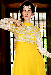 A desire that evokes a sense of belonging with a striking details. The dazzling yellow georgette anarkali churidar suit have amazing embroidery patch work is done with resham and lace work. Beautiful embroidery work on kameez is stunning. The entire ensemble makes an excellent wear. Matching churidar and dupatta is available with this suit. Slight Color variations are possible due to differing screen and photograph resolutions.