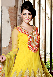 Take a look on the changing fashion of the season. The dazzling yellow net anarkali churidar suit have amazing embroidery patch work is done with resham, zari, sequins and lace work. Beautiful embroidery work on kameez is stunning. The entire ensemble makes an excellent wear. Matching churidar and dupatta is available with this suit. Slight Color variations are possible due to differing screen and photograph resolutions.