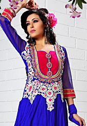 It is color this season and bright shaded suits are really something that is totally in vogue. The dazzling royal blue net anarkali churidar suit have amazing embroidery and velvet patch work is done with resham, gold zardosi, cutdana and stone work. Beautiful embroidery work on kameez is stunning. The entire ensemble makes an excellent wear. Matching santoon churidar and net dupatta is available with this suit. Slight Color variations are possible due to differing screen and photograph resolutions.