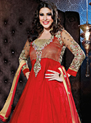 Attract all attentions with this embroidered suit. The dazzling red georgette anarkali churidar suit have amazing embroidery patch work is done with resham, zari, stone and lace work. Beautiful embroidery work on kameez is stunning. The entire ensemble makes an excellent wear. Matching santoon churidar and shaded chiffon dupatta is available with this suit. Slight Color variations are possible due to differing screen and photograph resolutions.