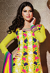 Look stunning rich with dark shades and floral patterns. The dazzling yellow chiffon anarkali churidar suit have amazing embroidery patch work is done with resham, zari and lace work. Beautiful embroidery work on kameez is stunning. The entire ensemble makes an excellent wear. Matching santoon churidar and chiffon dupatta is available with this suit. Slight Color variations are possible due to differing screen and photograph resolutions.