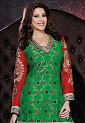 Dreamy variation on shape and forms compliment your style with tradition. The dazzling green viscose georgette and jacquard sharara kameez have amazing embroidery patch work is done with resham, zari, sequins and lace work. Beautiful embroidery work on kameez is stunning. The entire ensemble makes an excellent wear. Contrasting white sharara and red chiffon dupatta is available with this suit. Slight Color variations are possible due to differing screen and photograph resolutions.