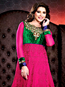 Take a look on the changing fashion of the season. The dazzling deep pink georgette long style anarkali churidar suit have amazing embroidery and velvet patch work is done with resham, zari, stone and lace work. Beautiful embroidery work on kameez is stunning. The entire ensemble makes an excellent wear. Contrasting green santoon churidar and shaded chiffon dupatta is available with this suit. Slight Color variations are possible due to differing screen and photograph resolutions.