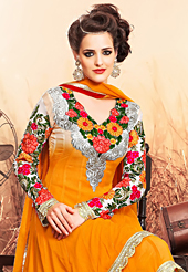 The fascinating beautiful subtly garment with lovely patterns. The dazzling orange georgette anarkali churidar suit have amazing embroidery patch work is done with resham, zari and lace work. Beautiful embroidery work on kameez is stunning. The entire ensemble makes an excellent wear. Contrasting off white santoon churidar and orange chiffon dupatta is available with this suit. Slight Color variations are possible due to differing screen and photograph resolutions.