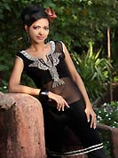 Black chiffon tunis is simple designed with beautiful embroidered patch work on neckline which is embllished with resham, zari sequins, stone and sitara works. This readymade indo western tunic use for casual purpose.  Slight Color variations are possible due to differing screen and photograph resolutions.