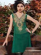 Green chiffon tunis is simple designed with beautiful embroidered patch work on neckline which is embllished with resham, zari sequins, stone and sitara works. This readymade indo western tunic use for casual purpose.  Slight Color variations are possible due to differing screen and photograph resolutions.