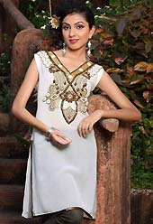 White chiffon tunis is simple designed with beautiful embroidered patch work on neckline which is embllished with resham, zari sequins, stone and sitara works. This readymade indo western tunic use for casual purpose.  Slight Color variations are possible due to differing screen and photograph resolutions.