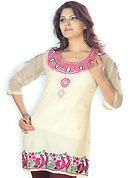 Light Fawn cotton tunic is nicely designed with resham embroidery patch work on neckline and sleeves done with resham work. Amazing peacock patterned border is highlighting the beauty of this tunic. This is a perfect casual wear. Slight Color variations are possible due to differing screen and photograph resolutions.
