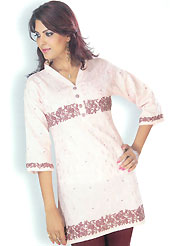 This Peach cotton tunic is designed with resham embroidery work on all over in floral patterns. This is a perfect casual wear. Slight Color variations are possible due to differing screen and photograph resolutions.