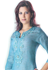 This Light Blue cotton tunic is designed with resham and stone workes embroidery work in floral patterns. This is a perfect casual wear. Slight Color variations are possible due to differing screen and photograph resolutions.