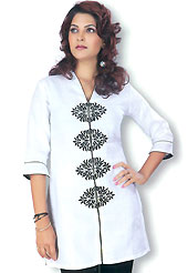 This White cotton tunic is designed with resham embroidery work in floral patterns. This is a perfect casual wear. Slight Color variations are possible due to differing screen and photograph resolutions.