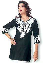 This Black cotton tunic is designed with resham embroidery patch work on neckline in floral patterns. This is a perfect casual wear. Slight Color variations are possible due to differing screen and photograph resolutions.
