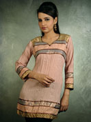Get that divine look with this trendy cotton crushed faun kurti. It has some exciting brocket lace work done on its base, sleeves, and on the shoulders that highlights the look of the kurti. It has some interesting sequin work done to make it look unique and mesmerizing. Suitable for casual wear.