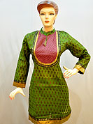 Simple captivating cotton kurti is nicely designed with butti print on all over. Quilted fabric patch work on neck with lace. Golden border on kurti and sleeves. Color of this kurti is light green and red. It's a daily wear drape. Slight Color variations are possible due to differing screen and photograph resolutions.
